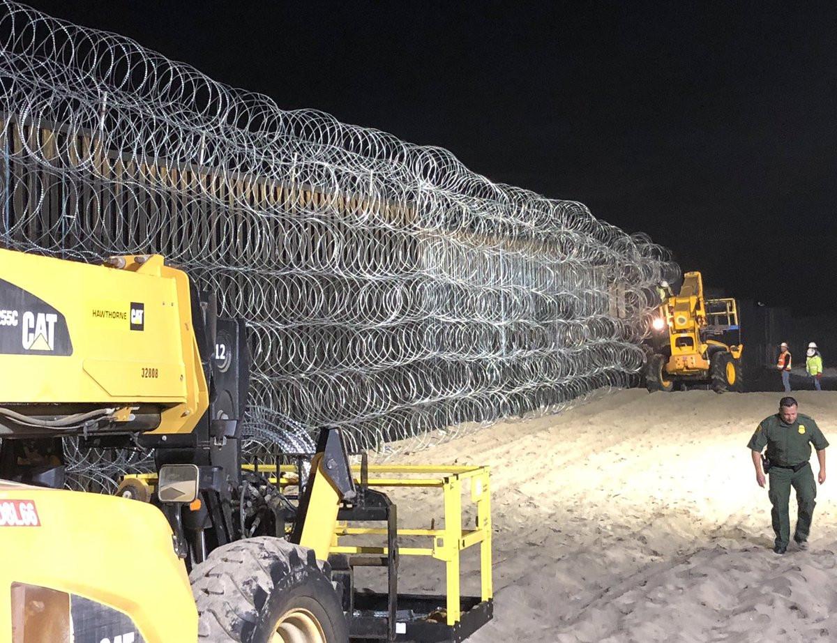 miles of razor wire us mexico border migrant caravan