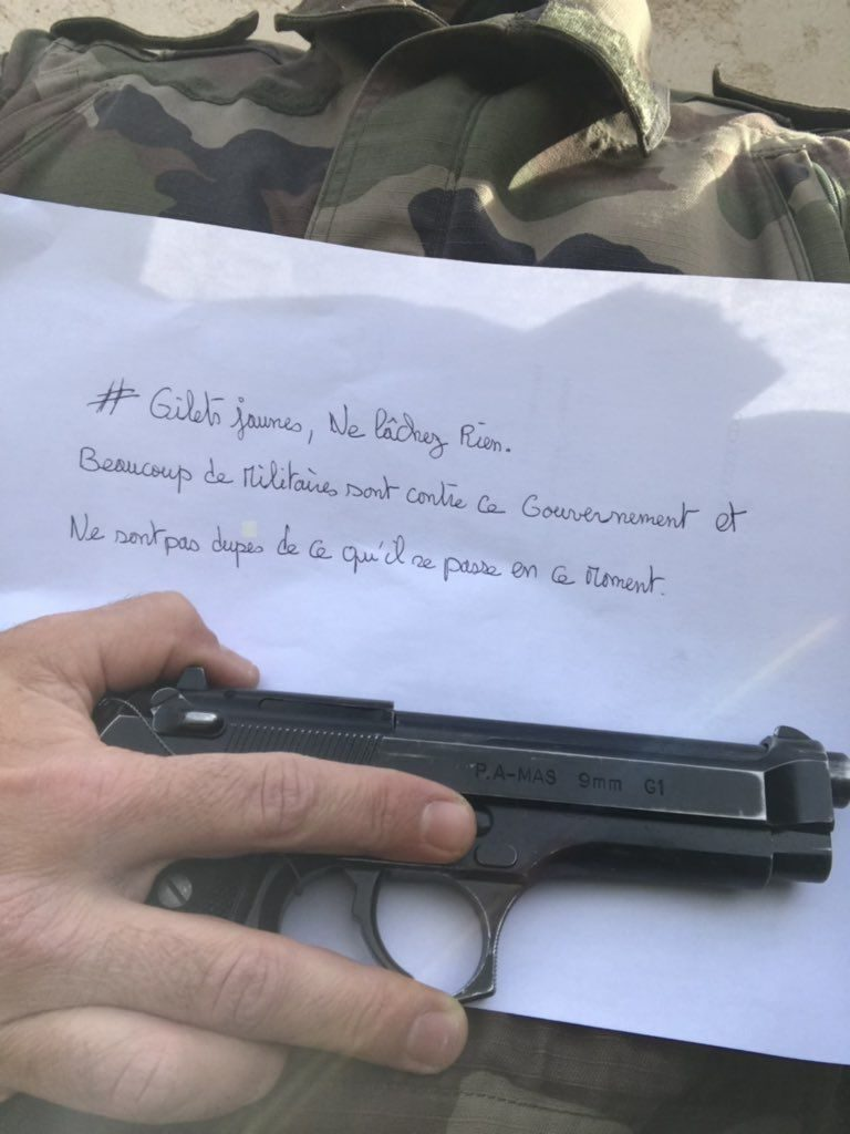 French Military Officer Gun Supports Yellow Vest Movement