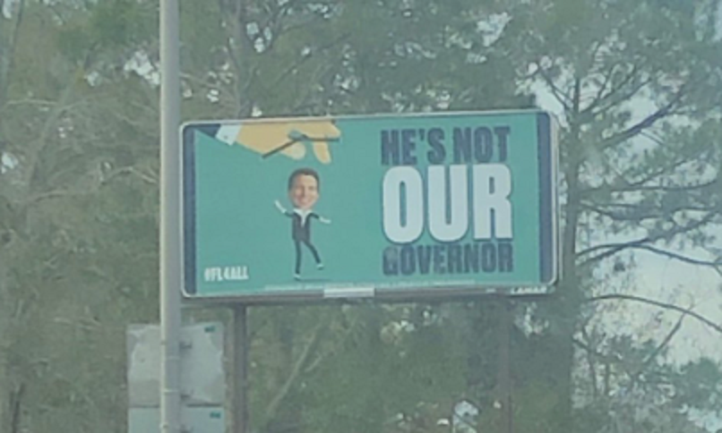Ron DeSantis Florida He's Not Our Governor Billboard 3