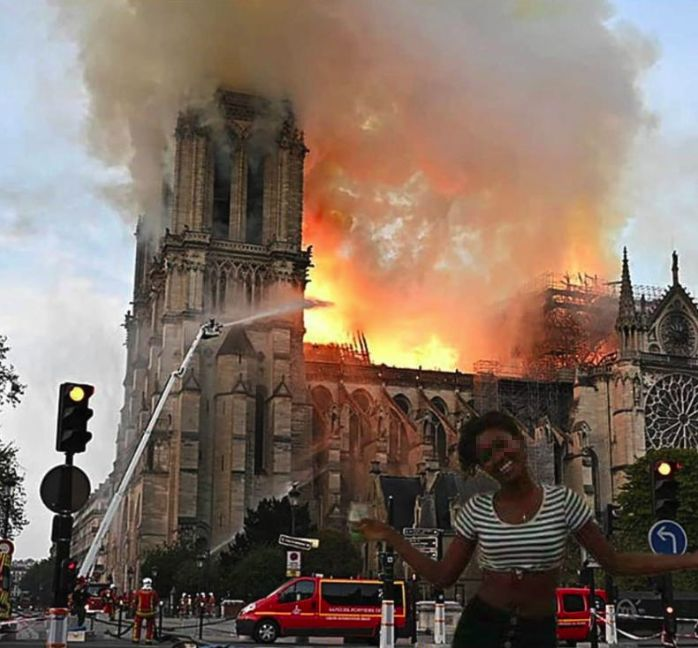 Woman Celebrating Notre Dame Cathedral Fire_censored