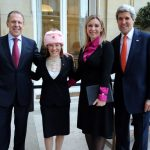 Biden's WH Press Secretary Jen Psaki Wearing Pink Communist Ushanka 1